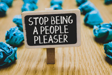 Handwriting Text Writing Stop Being A People Pleaser. Concept Meaning Do What You Like Not Things Other People Want Stand Blackboard With White Words Behind Blurry Blue Paper Lobs Woody Floor