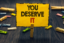 Word Writing Text You Deserve It. Business Concept For Reward For Something Well Done Deserve Recognition Award Blacky Wooden Desk Laid Paper Clip Randomly One Hold Yellow Board With Text