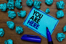Conceptual Hand Writing Showing You Are Here. Business Photo Showcasing This Is Your Location Reference Point Global Positioning System Written Blue Letters On Page Blue Marker And Paper Lumps
