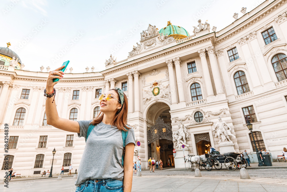 Fototapety, obrazy: Young asian tourist taking selfie photo on her smartphone in Vienna, Austria