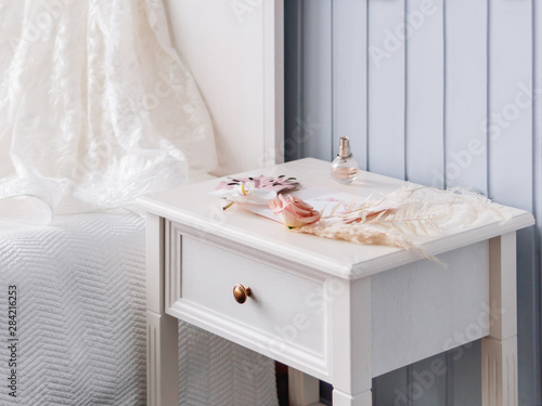 Canvas Print Gray bedside table with bridal accessories