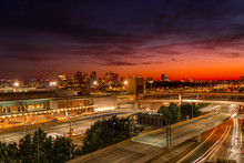 Colorful Sunset Sky Over Boston Downtown And Logan Airport With Cars Passing By