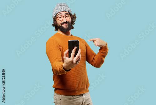 Obraz young bearded man with a smart phone - fototapety do salonu