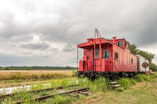 Red Caboose In Summer