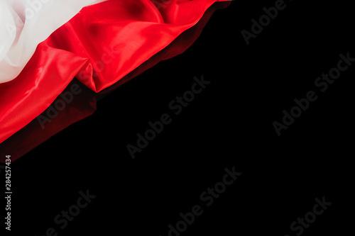 Fotografía  Polish flag on a black background with reflection