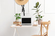canvas print picture - Stylish workplace with modern laptop near white wall