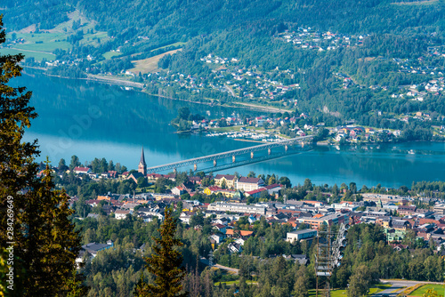 Fotobehang Noord Europa View of Lillehammer town with mountains, river and buildings.