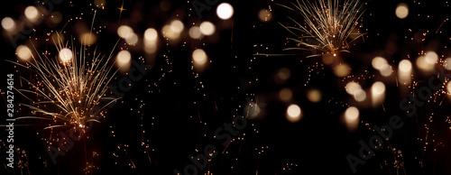 Cuadros en Lienzo Golden firework in the night sky