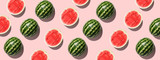 Colorful fruit background of fresh half watermelon on pink background