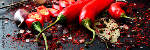 Tuinposter Hot chili peppers Fresh Chili pepper on dark background. Close-up