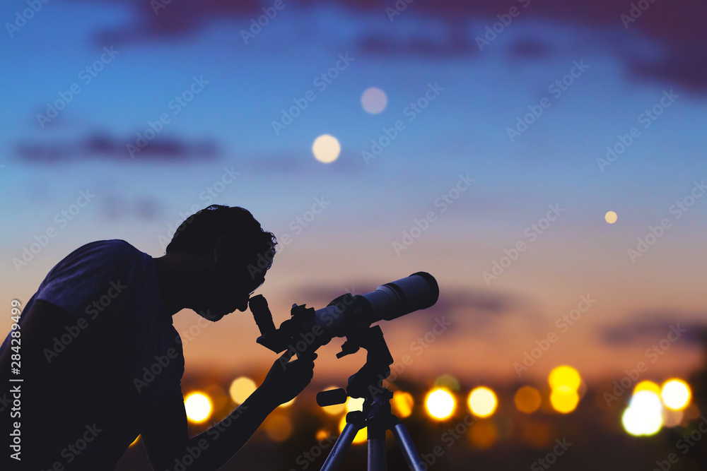 Fototapety, obrazy: Astronomer with a telescope watching at the stars and Moon. My astronomy work.