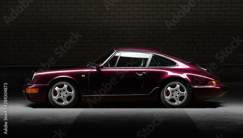 Fototapeta Aachen, Germany, June 14, 2013: Arranged Street shot of an historic Porsche 911