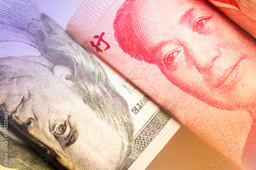 Fotografering Face to face of Benjamin Franklin and Mao Tse tung from US dollar and China Yuan banknote