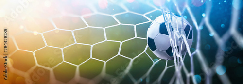 Photo  Soccer Ball in Goal Multicolor Background