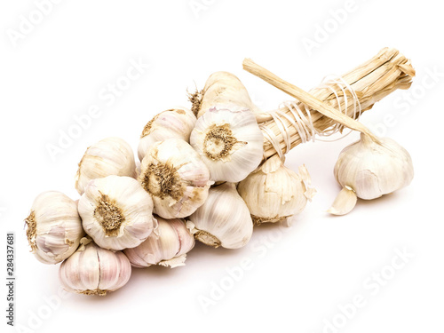 Fototapeta Garlic string with separate bulb and clove isolated on white background obraz