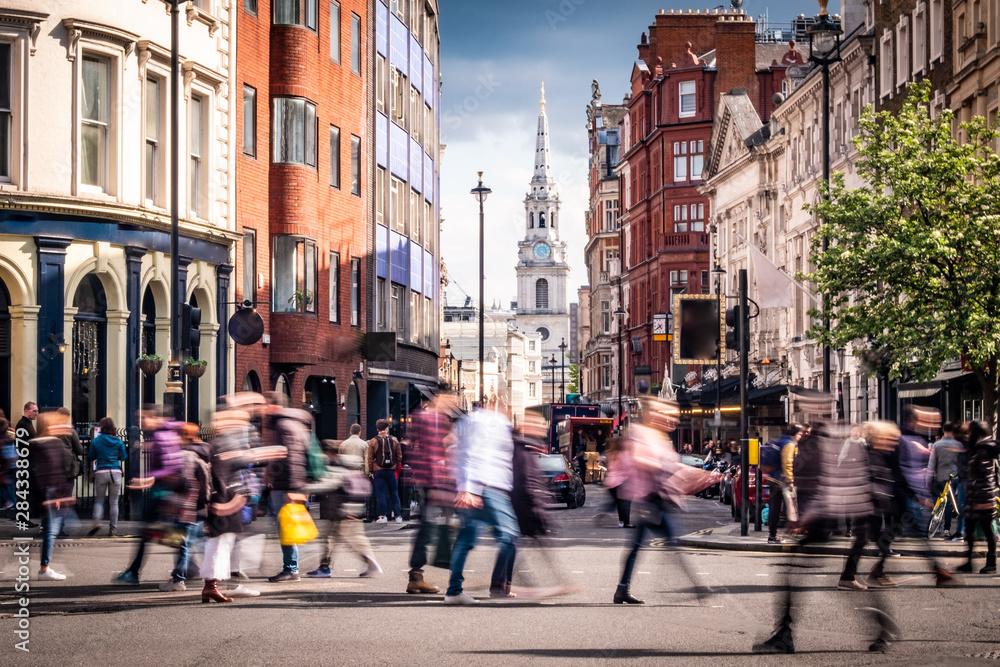 Fototapeta Motion blurred people on busy street in London's West End, UK