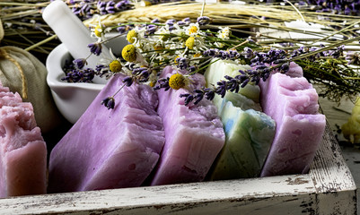 Fototapeta Lawenda Handmade Soap with dried lavender and chamomile flowers