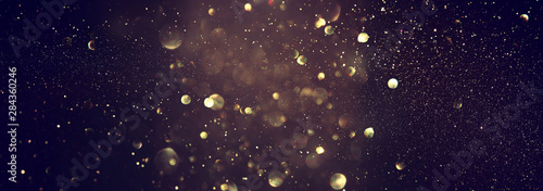 blackground of abstract glitter lights. blue, gold and black. de focused. banner - 284360246