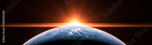Платно Sunrise over the planet Earth concept with a bright sun and flare and city light