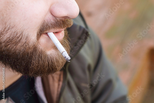 Fényképezés  Portrait of brutal hipster adult working man after labor day with a beard close