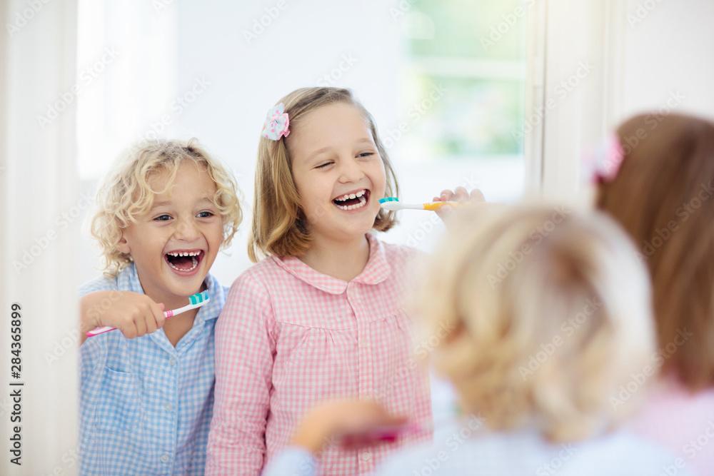Fototapety, obrazy: Child brushing teeth. Kids with toothpaste, brush.