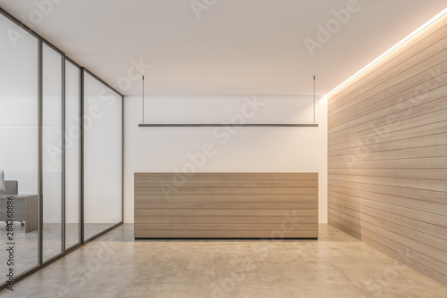 Wooden reception desk in white office