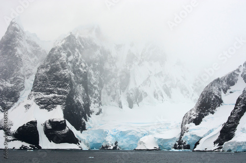 Antarctica. Lemaire Channel. Glacier covered mountains.