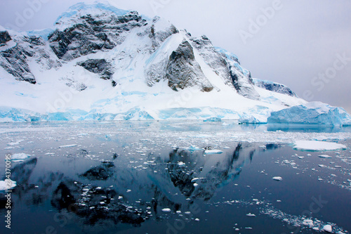 Aurora Passage Antarctica. Ice-covered mountain with reflection.