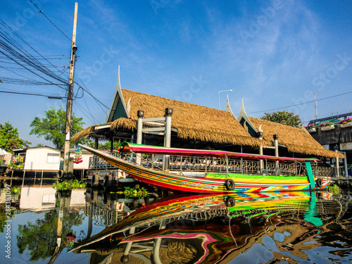 Fényképezés  Southeast Asia, Thailand, Bangkok, Boat in reflection in back canals