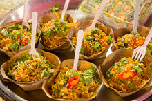 Thailand, Chiang Mai. Night Market, Street Food, Curry Served In Leaf Bowls.