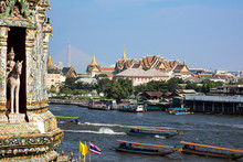 Bangkok, Thailand. Wat Arun, Temple Of Dawn, A View From The Top Of The Prang Across The Chao Phraya River Of The Wat Phra Kaew, Grand Palace, Temple Of The Emerald Buddha