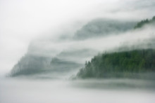 Canada, British Columbia, Fiordland Recreation Area. Mist And Fog Shroud Water And Forested Island.