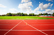 canvas print picture - Red running track in stadium
