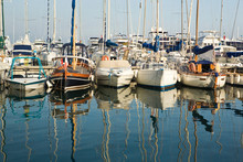 Boats And Reflections In The Marina Area Of Beaulieu Sur Mer. On The Coastline In The South Of France.