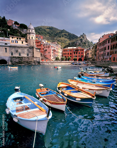 Garden Poster Liguria Italy, Vernazza. Brightly painted boats line the dock at Vernazza Harbor, Cinque Terra, a World Heritage Site, Italy.