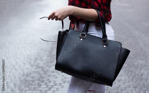 Woman holding black leather bag Canvas Print