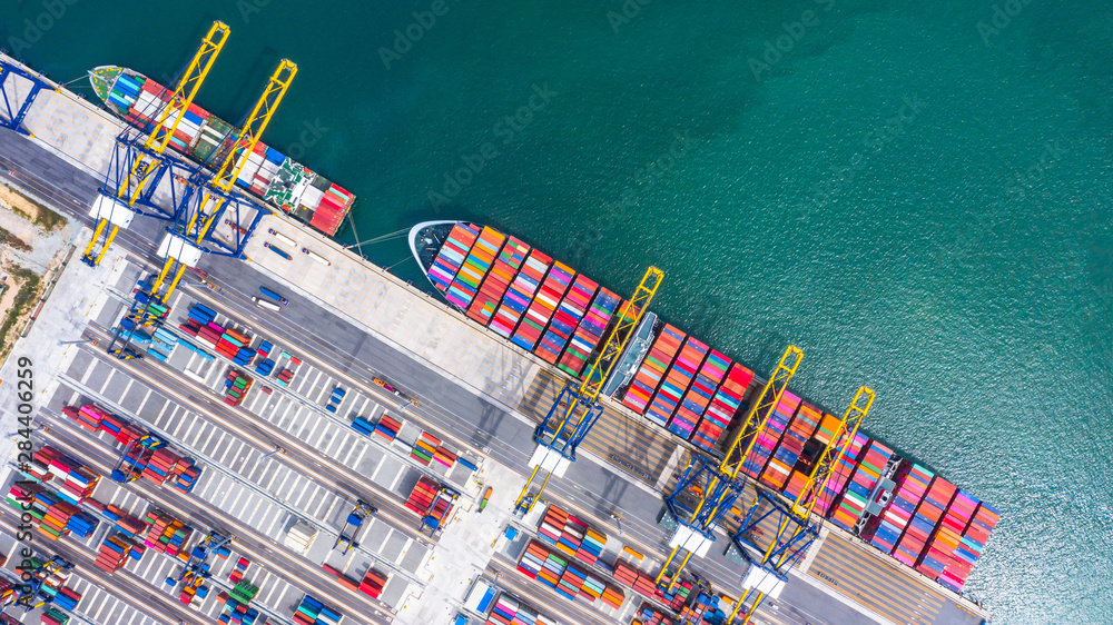 Fototapeta Container cargo ship loading and unloading , Aerial top view of boat business commerce logistic commercial import and export freight  transportation by container cargo ship in open sea.