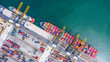 Leinwandbild Motiv Container cargo ship loading and unloading , Aerial top view of boat business commerce logistic commercial import and export freight  transportation by container cargo ship in open sea.