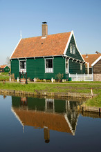 The Netherlands (aka Holland), Zaandam. Zaanse Schans, Historic Open Air Museum Of Life In The 17th Century. Tradidional Dutch Green Wooden Homes.