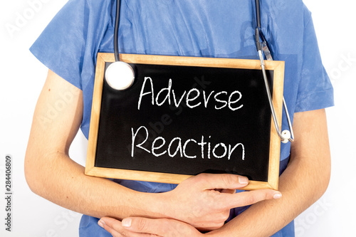 Doctor shows information on blackboard: adverse reaction Canvas Print