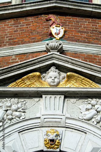 Netherlands (aka Holland), West Friesland, Hoorn. Historic facade with city crest & gold winged angel.