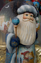 Russia, Moscow, Red Square. Traditional Russian Wood Carved Santa.