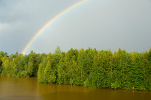 Russia, Typical River Views Between Goritzy & Kizhi Island. White Lake Area, Rainbow Over The Forest.