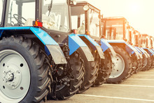 Many Different Tractors Standi...