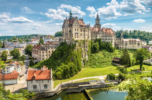 Sigmaringen Castle in summer, Baden-Wurttemberg, Germany. This beautiful castle is a landmark of Swabia. Panorama of town with castle on rock above Danube river. Skyline of old German city.