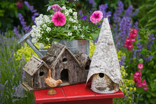 Close-up Of Bird Houses And Pl...