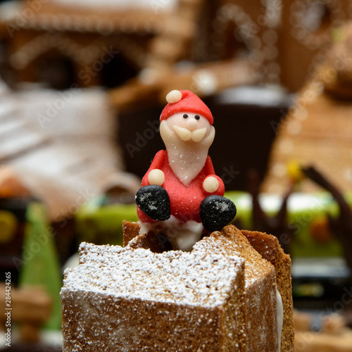 Marzipan Santa, in gingerbread village.