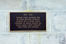 Papua New Guinea, Lae. World War II Memorial Plaque In Pidgin.