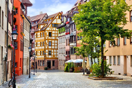 Spoed Foto op Canvas Oude gebouw Beautiful street of half timbered buildings in the picturesque Old Town of Nuremberg, Bavaria, Germany