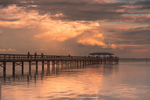 Fishing Pier Off Safety Harbor, Florida. Sunset With People Fishing